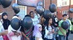 Black balloons mark anniversary